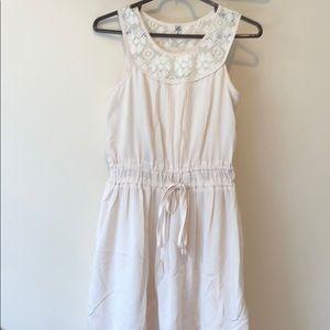 Cream colored boutique dress in size small